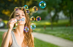 Easy as blowing bubbles. Stock Photos