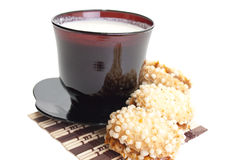 Easy breakfast. Cup of milk on a black saucer with tasty cookies.  Easy breakfast Stock Photo