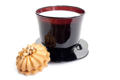 Easy breakfast. Cup of milk on a black saucer with tasty cookies.  Easy breakfast Royalty Free Stock Photos