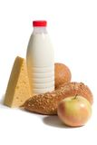 Easy breakfast. Cheese, apple, bottle of milk and bread isolated on white background royalty free stock image