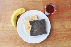 Easy breakfast with bread, banana and roselle juice Royalty Free Stock Photo