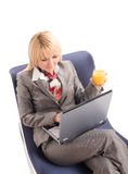 Easy business. Businesswoman with laptop and glass of fresh orange juice rest in chair over white background Concept about fresh solutions and ideas n business stock photos