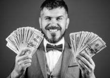 Easy cash loans. Win lottery concept. Businessman got cash money. Get cash easy and quickly. Cash transaction business. Man happy winner rich hold pile of stock image