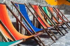 Easy Chairs in Different Colors. Colorful summer beach water sitting camping nice stock images
