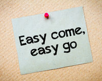 Easy come, easy go. Message. Recycled paper note pinned on cork board. Concept Image Stock Image