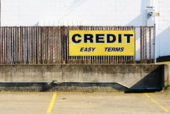 Easy Credit. A credit easy terms sign at a now out of business auto sales lot Stock Photos