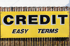 Easy Credit. A credit easy terms sign at a now out of business auto sales lot Royalty Free Stock Image