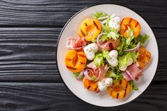 Easy Dietary Salad With Mozzarella, Prosciutto, Grilled Apricots, Red Onion And Lettuce Close-up On A Plate. Horizontal Top View Stock Images