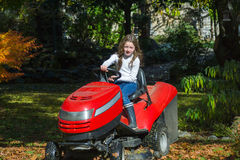 Easy driving of agrimotor by young girl Stock Image