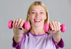 Easy exercises with dumbbells. Workout with dumbbells. Girl hold dumbbells. Biceps exercises for female. Fitness. Instructor. Healthy lifestyle concept. Woman stock image