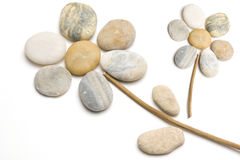 Easy flower made from pebbles. Easy flower made from little color pebbles Stock Images