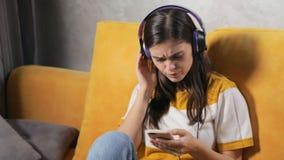 Girl Enjoys the Music in Earphones stock footage