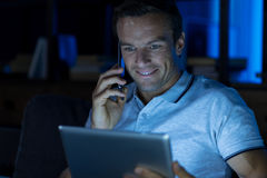 Easy going pleasant guy calling someone Royalty Free Stock Photo