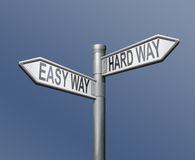 Easy hardway road sign arrow. Easy and hard ward roadsign arrow on blue background royalty free illustration