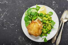 Free Easy Healthy Lunch: Chicken Thigh With Mashed Green Peas And Corn Salad On A Light Background. Top View Royalty Free Stock Images - 94595489