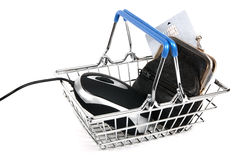 Easy internet shopping. Easy Web shopping with a computer mouse and a black leather wallet with a credit card in it , all in a shiny metal shopping basket Royalty Free Stock Photos