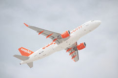 Easy Jet Airbus A320-200 taking off from Tenerife south airport on a cloudy day. Royalty Free Stock Images