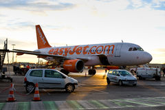 Easy Jet plane stuck on land. Due to bad weather conditions in Europe in january 2011, although people are boarding the plane is going nowhere Stock Photo
