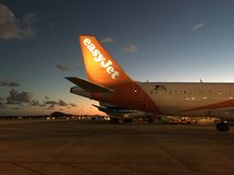 Easy Jet plane on the sunset Royalty Free Stock Images