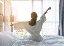 Free Easy Lifestyle Young Asian Girl Waking Up In The Morning Taking A Rest Relaxing In Hotel Room For World Lazy Day Royalty Free Stock Images - 169662379