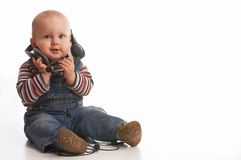 Easy listening. Baby boy is playing  with headset Stock Photos
