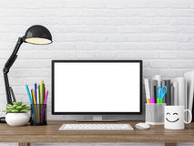 Easy loft working desk with blank computer monitor screen 3d rendering image. There are wood desk,white brick wall decorate with stationery Royalty Free Stock Photos