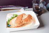 Easy meal with burger served on the plane. Easy meal with sausage burger served on the plane stock images