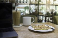 Easy meal in work hour with coffee drink and fried roti Royalty Free Stock Photography