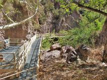 Whitewater Canyon Catwalk. The easy 1.1-mile Catwalk National Recreation Trail winds through the canyon's steep, pink walls of volcanic rock Royalty Free Stock Photos
