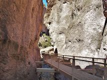 Whitewater Canyon Catwalk. The easy 1.1-mile Catwalk National Recreation Trail winds through the canyon's steep, pink walls of volcanic rock Royalty Free Stock Image