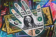 Easy Money. Hand over a pile of american dollar banknotes Royalty Free Stock Image