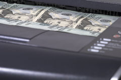 Easy Money. Money in a printer out tray Royalty Free Stock Image
