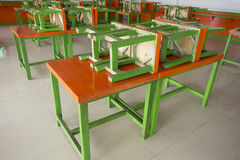 Easy movable orange and green wooden tables and chairs for using in any open area events. The open area such as beer yard, beer ga Stock Photos