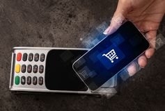 Hand shopping with mobile phone. Easy paying with mobile phone in the marketn royalty free stock images