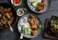 Easy peri-peri chicken livers and rice on a dark background, top view. Stock Image