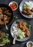 Easy peri-peri chicken livers and rice on a dark background, top view. Royalty Free Stock Photo