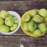 Easy pickings. Cooking apples in retro bowls Stock Images