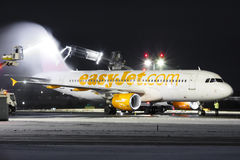 Easy. PRAGUE, CZECH REPUBLIC - JANUARY 6: EasyJet Airline Airbus A319 during de-icing procedure PRG Airport on January 7, 2016. EasyJet is the second-largest low Stock Image