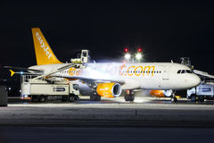 Easy. PRAGUE, CZECH REPUBLIC - JANUARY 6: EasyJet Airline Airbus A319 during de-icing procedure PRG Airport on January 7, 2016. EasyJet is the second-largest low Royalty Free Stock Photos