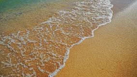 Easy sea wave caresses beach sand. Shot with Sony A7s stock footage