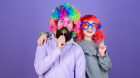 Easy simple ways be fun playful parent. Man bearded father and girl wear colorful wig while eat lollipop candy. Thing. Loving father do for children. Tribute to stock image