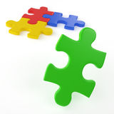 The easy solution. Four colored puzzle pieces isolated on white with only one left to assemble as concept for easy solution to a problem Royalty Free Stock Image
