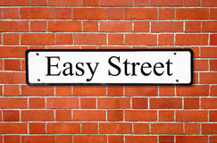 Easy street sign. Easy street sign on a brick wall royalty free stock photography