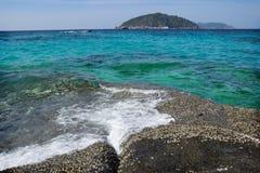 Easy surf washes coastal stones Stock Photos