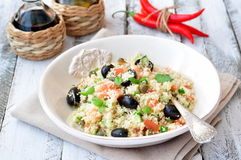 Easy vegetarian salad from a couscous with vegetables and olives Royalty Free Stock Image