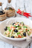 Easy vegetarian salad from a couscous with vegetables and olives Stock Photography