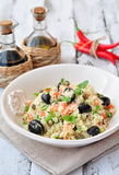 Easy vegetarian salad from a couscous with vegetables and olives Royalty Free Stock Photography