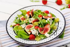 Easy vegetarian salad with figs, strawberries, grapes, blue cheese. `Dorblu` and lettuce Royalty Free Stock Photography