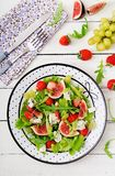 Easy vegetarian salad with figs, strawberries, grapes, blue cheese. `Dorblu` and lettuce. Flat lay. Top view Royalty Free Stock Photography