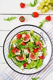 Easy vegetarian salad with figs, strawberries, grapes, blue cheese Stock Photo